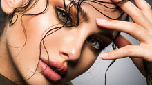 Closeup Portrait Of A Beautiful Young Woman With Brown Gkamour Makeup. Model Looking At Camera..