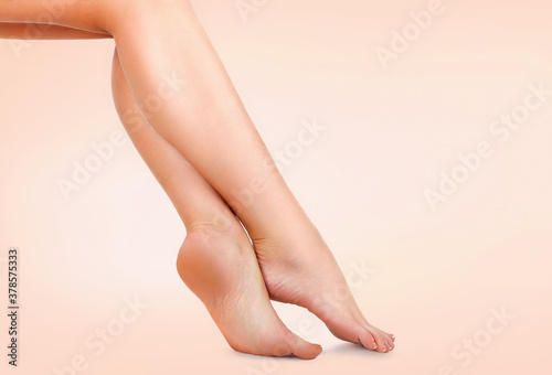 Beautiful female legs with smooth skin after depilation. Waxing concept #378575333