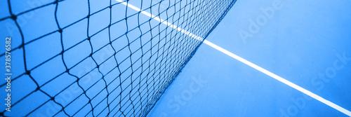 Fotografiet Tennis net on the tennis court. Selective focus