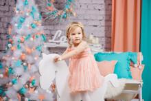 A Little Girl In A Pink Dress ...