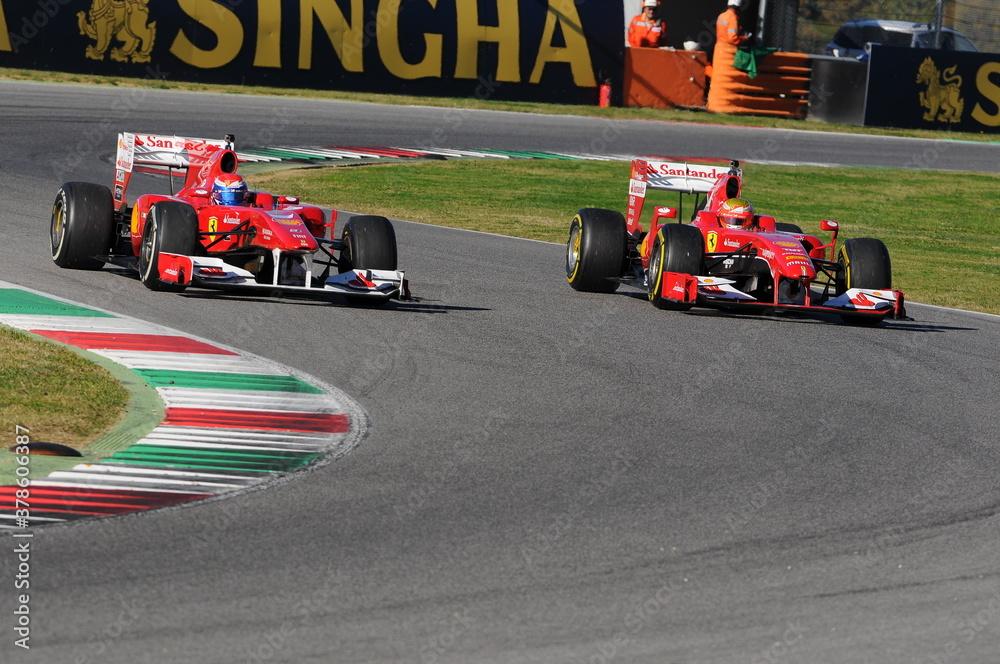 MUGELLO CIRCUIT, ITALY - October 2015: Sebastian Vettel, Kimi Raikkonen, Marc Gene, Esteban Gutierrez of Scuderia Ferrari F1 on Show session during Ferrari Racing Days 2015, in Mugello Circuit, Italy.