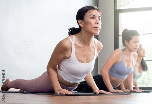 Group of women doing exercise or yoga at home