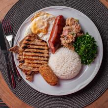 .Typical Dish Of Brazilian Cuisine Called Virado A Paulista. Top View