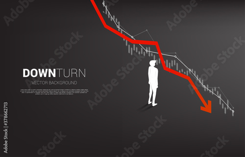 Photo silhouette of businessman standing downturn graph