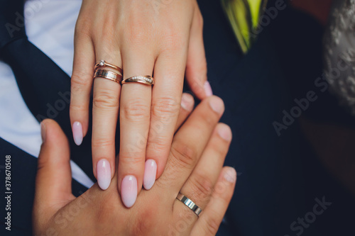 Obraz na plátně Newlyweds exchange rings, groom puts the ring on the bride's hand in marriage registry office