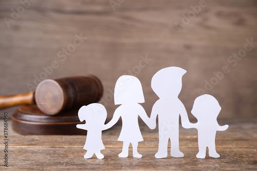 Fototapeta Family figure and judge gavel on wooden table. Family law concept obraz