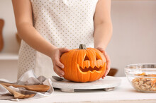 Woman Carving Pumpkin For Hall...