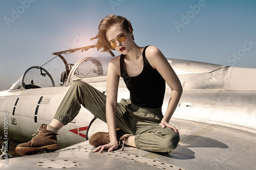 girl pilot sits on wing Canvas Print