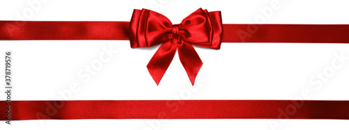 Canvastavla Red shiny bow with ribbons with long ribbon extending on both sides