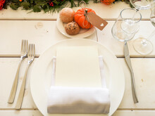 White Striped Wooden Table, With Plate And Cutlery. Pumpkin With Bread.