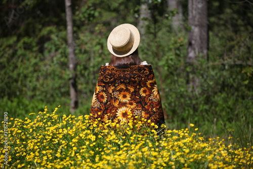 Photo Girl in vintage Pavlovo Posad shawl and straw hat