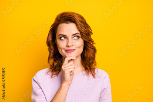 Fototapeta Closeup photo of funny wavy lady dreamer looking empty space remember romantic date boyfriend kisses arm on chin wear casual pink pullover isolated yellow color background obraz