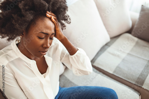 Fototapeta Young hopeless woman suffering from depression having nervous breakdown holding head on isolated background, copy space