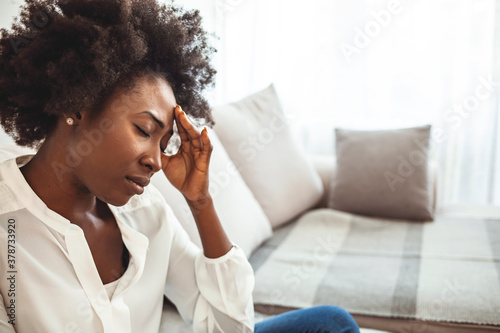 Carta da parati Sad tired young woman touching forehead having headache migraine or depression,