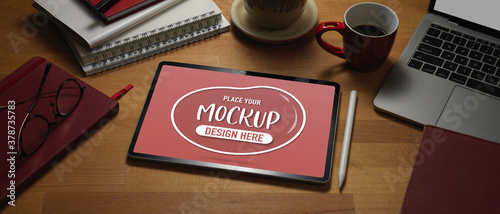 Mock up digital tablet on wooden worktable with laptop and supplies Wallpaper Mural