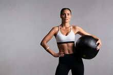 Determined Fitness Woman On Gr...