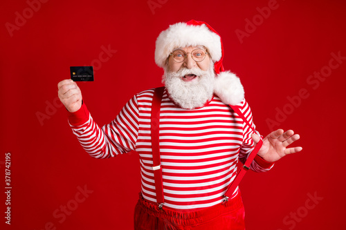 Vászonkép Portrait of his he handsome cheerful bearded Santa holding in hand card order us
