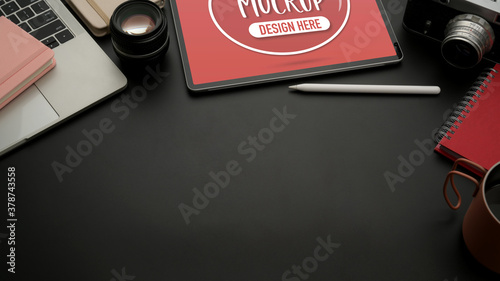 Black worktable with mock up tablet, laptop, camera, supplies and copy space Wallpaper Mural