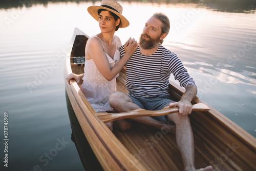 Fototapeta Man and woman enjoy boat ride obraz