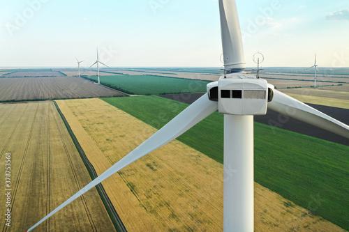 Modern windmill in wide field, closeup. Energy efficiency