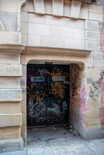 Sheffield,  UK – 30 Nov 2018 : A Graffiti Covered Old Door And Archway At High Court