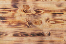 Textured Wooden Background From Boards Of Spruce, Burnt By The Fire. The Texture Of Wood, Sawn Branches On The Wooden Surface.