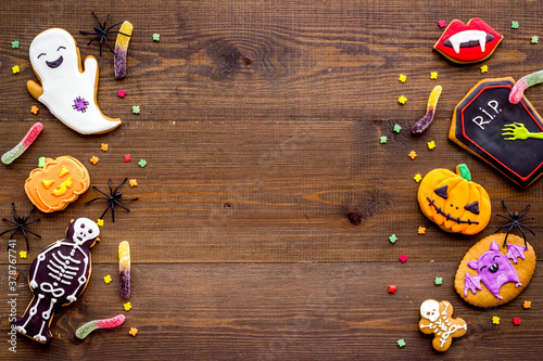 Fototapeta Overhead view of Halloween decorations with cookies and candies, top view obraz