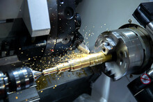 Metal Machine Tools Industry. CNC Turning Machine High-speed Cutting Is Operation.flying Sparks Of Metalworking