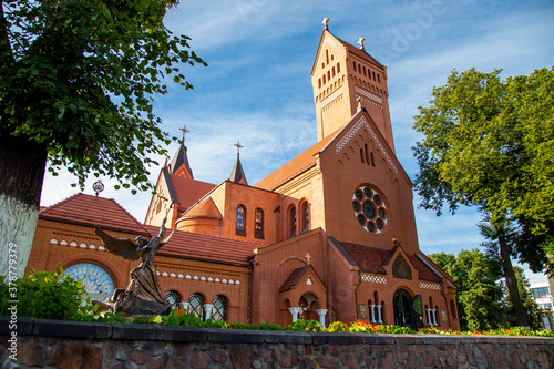 A church with the city center made of red stone bricks of Saints Simeon and Helena on Independence Square in Minsk, Belarus Fototapet