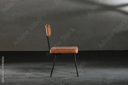 Valokuvatapetti Wooden chair with metal legs in a studio