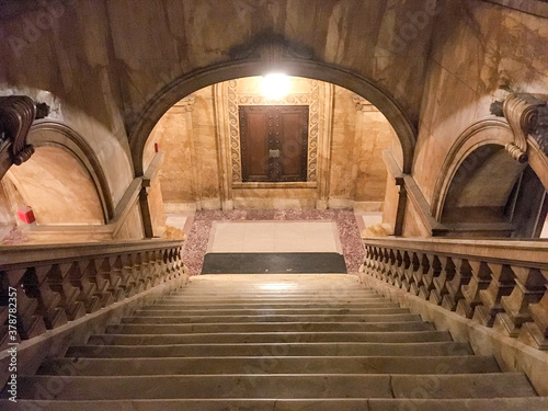 Impressive marble staircase or stairwell in historic public building with railin Canvas Print