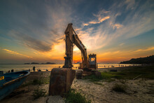 Excavator Working At The Sandy...