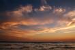 canvas print picture Beautiful sunset in sky, sandy beach on sea coast