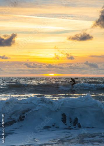 Fotomural Surfer at Sunset at Widemouth Bay - Bude, Cornwall, England