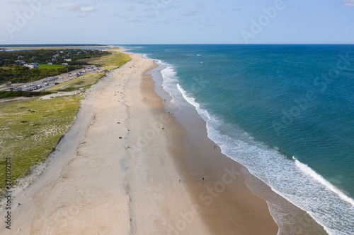 Fototapeta The cold water of the Atlantic Ocean washes onto the sandy beaches of Cape Cod, Massachusetts