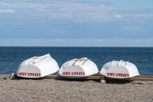 Three White Lifeguard Rescue R...
