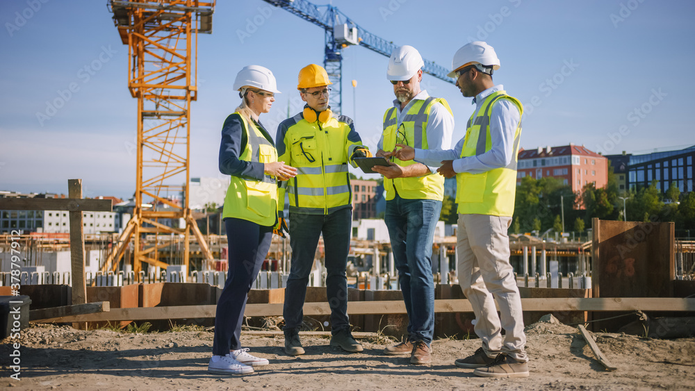 Fototapeta Diverse Team of Specialists Use Tablet Computer on Construction Site. Real Estate Building Project with Civil Engineer, Architect, Business Investor and General Worker Discussing Plan Details.