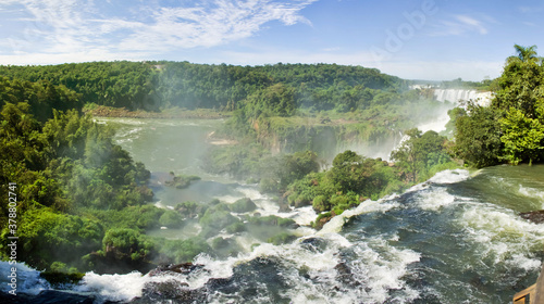 Fotografie, Obraz Large nature panorama of Iguacu (Iguazu) waterfall cascade on border of Brazil and Argentina