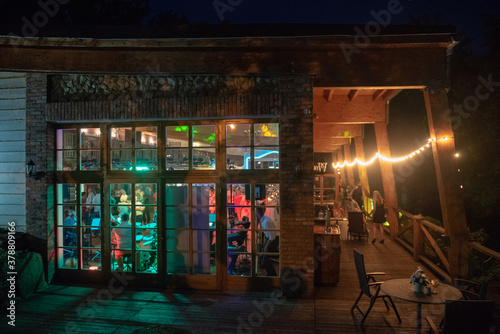 Photo View of restaurants from outside at night. Wedding party