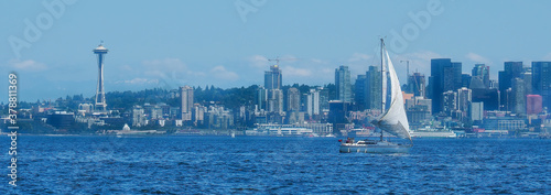Small sailboat sailing in Elliott Bay with Seattle Skyline in background Wallpaper Mural