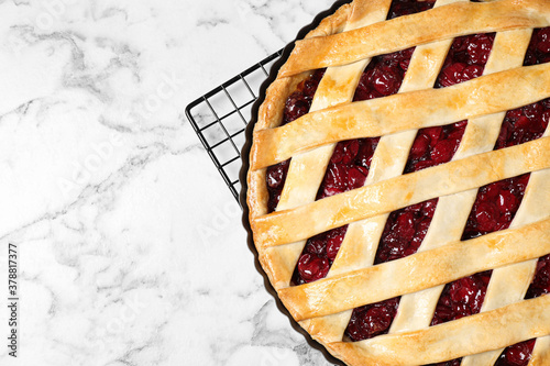 Delicious fresh cherry pie on white marble table, top view Wallpaper Mural