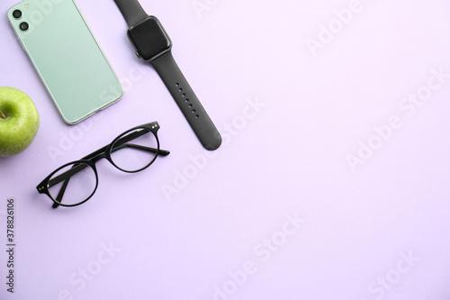 Obraz na płótnie Flat lay composition with stylish smart watch on violet background