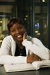 Smiling Black student studying