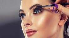 Makeup Artist Applies  Mascara...