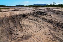 Vehicle Tracks Gouged Into The Salt Flat Mud