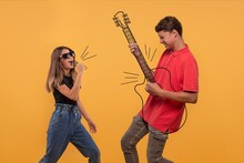 Young Teenagers Dreaming Of A Musical Career Give A Concert On Imaginary Instruments.