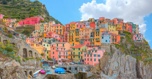 Manarola Town, Cinque Terre Italy At The Ligurian Sea - Five Famous Colorful Villages Of Cinque Terre - Colorful Cityscape On The Mountains Over Mediterranean Sea
