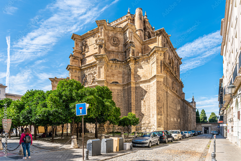 Fototapeta Granada, Spain October 17th, 2019. VView of the Royal Monastery of San Jerónimo from Calle Compás de San Jerónimo on a sunny day with clear skies.