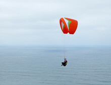 Paraglider Flying Over The Sea