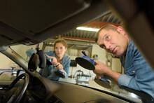 Mechanic Removing Windshield U...